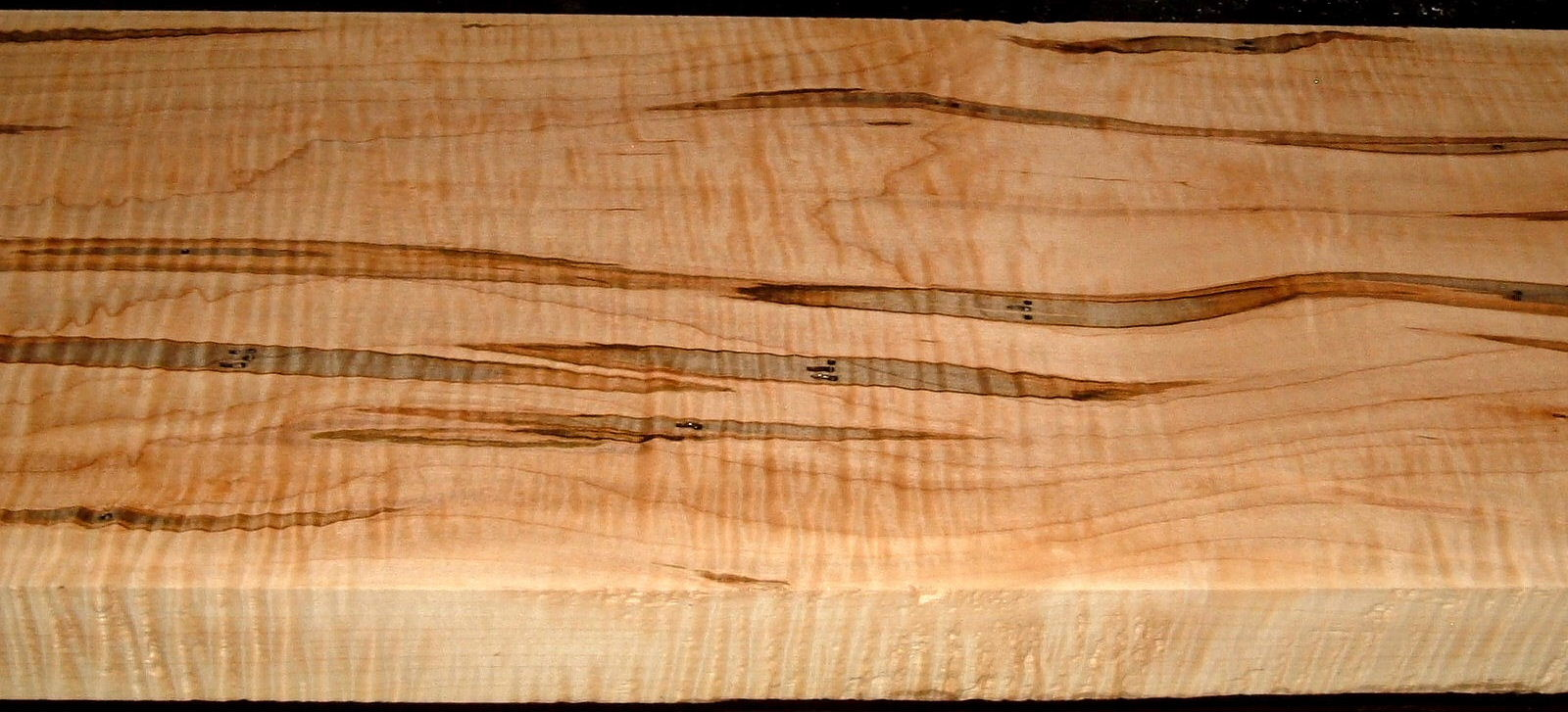 AM2002-44L, 1-5/8x9-1/2x53, Curly Tiger Ambrosia Wormy Maple