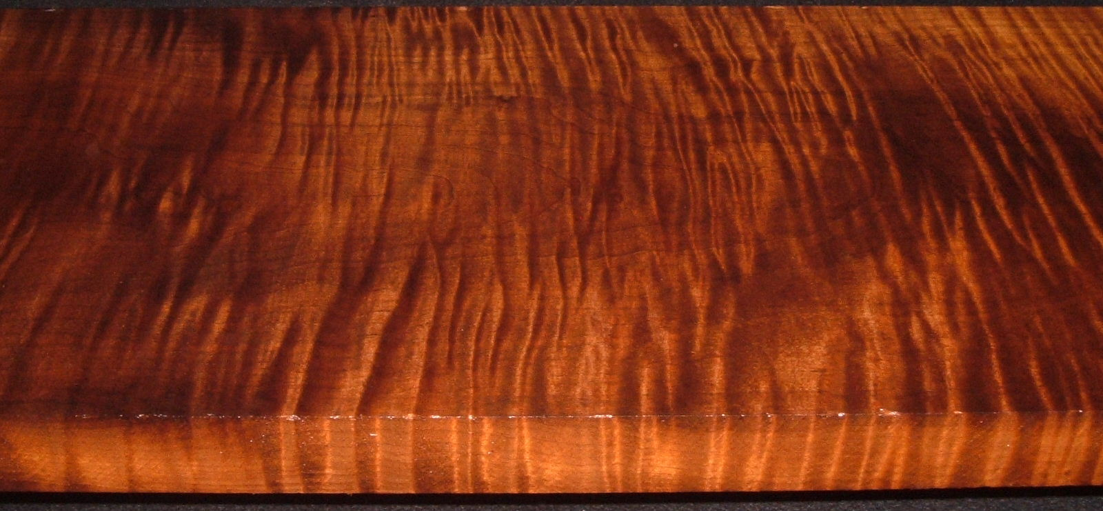RM2006-192L, 1-7/16x11-1/4x53, Roasted Curly Maple