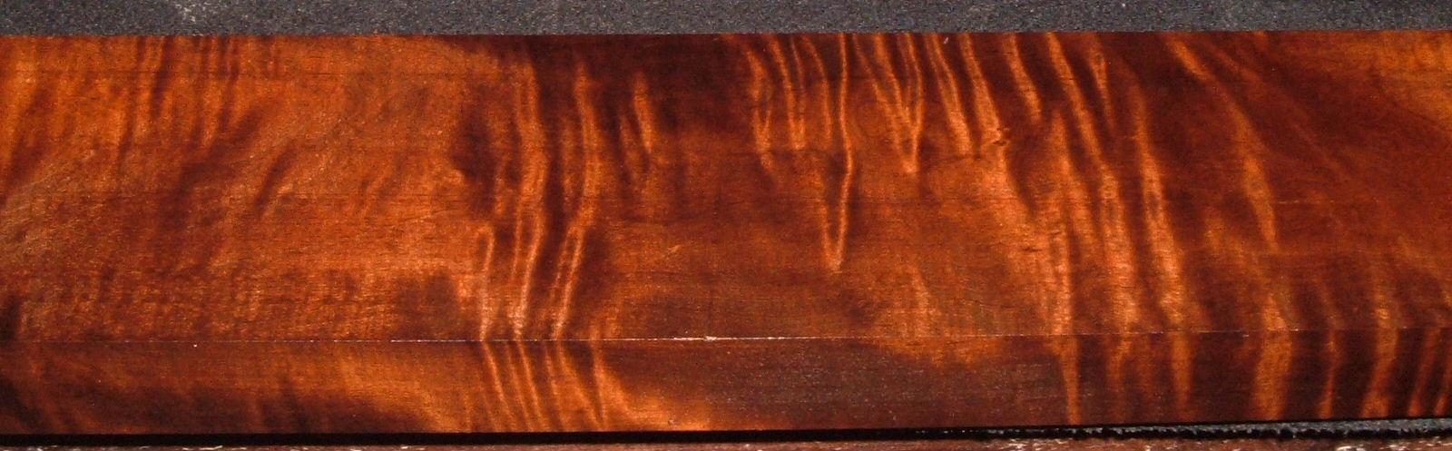 RM2104-122, 1-3/8x4x49, Roasted Curly Maple